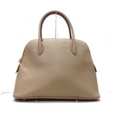 ココセリュックスゴールドのハンドバッグ
