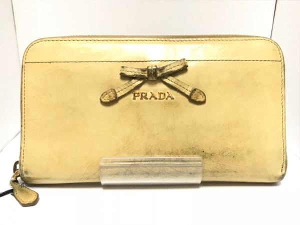 PRADA(プラダ) 長財布 - 1M0506 イエロー ラウンドファスナー/リボン レザー