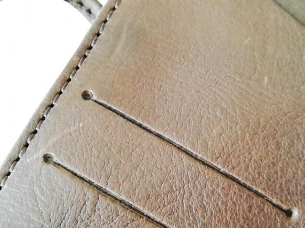 SLOW(スロウ) 手帳美品  ダークブラウン レザー×金属素材