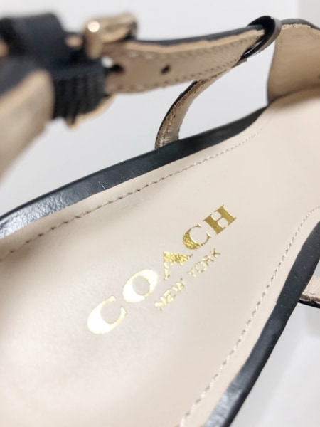 COACH(コーチ) サンダル 35.5 レディース美品  黒 ウェッジソール/リボン レザー
