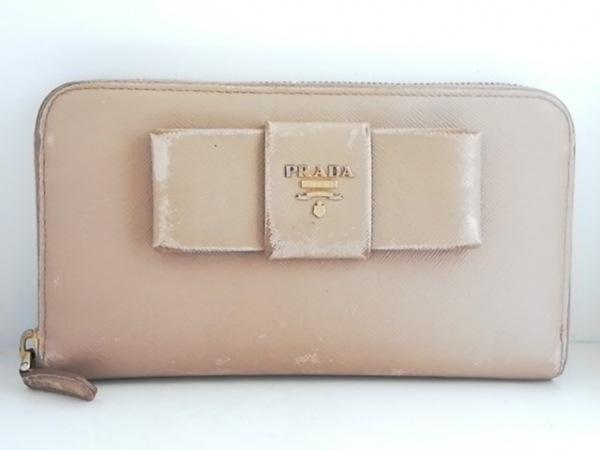 PRADA(プラダ) 長財布 - 1M0506 ベージュ ラウンドファスナー/リボン レザー