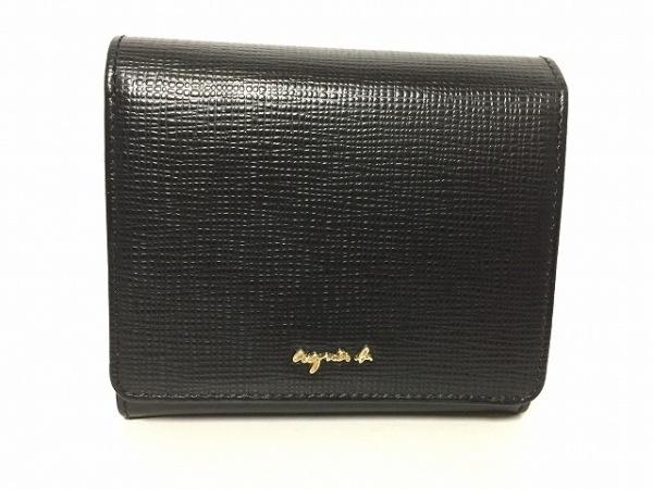 agnes b(アニエスベー) 2つ折り財布美品  黒 型押し加工 レザー