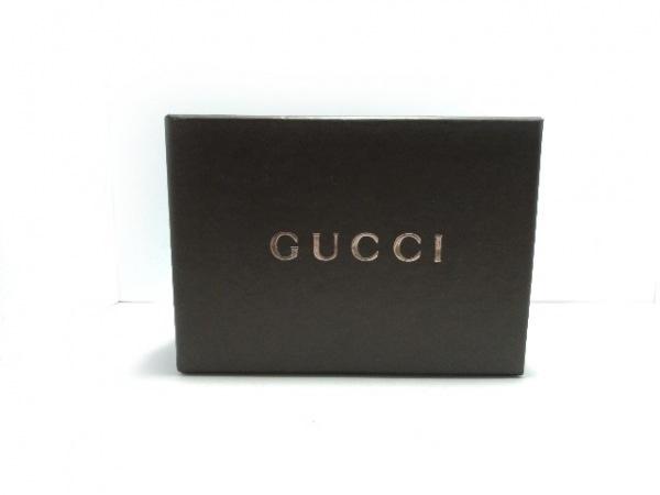 GUCCI(グッチ) シガレットケース GG柄 - 黒×ゴールド ジャガード×金属素材
