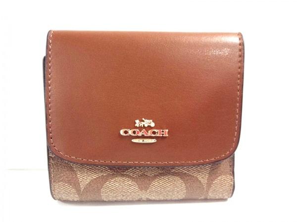 on sale c0e64 2e270 コーチ 3つ折り財布美品 シグネチャー スモール ウォレット F87589 カーキ×ブラウン