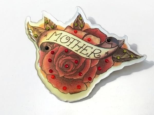 エヌドゥバイレネレイド ブローチ 金属素材×カラーストーン 花柄