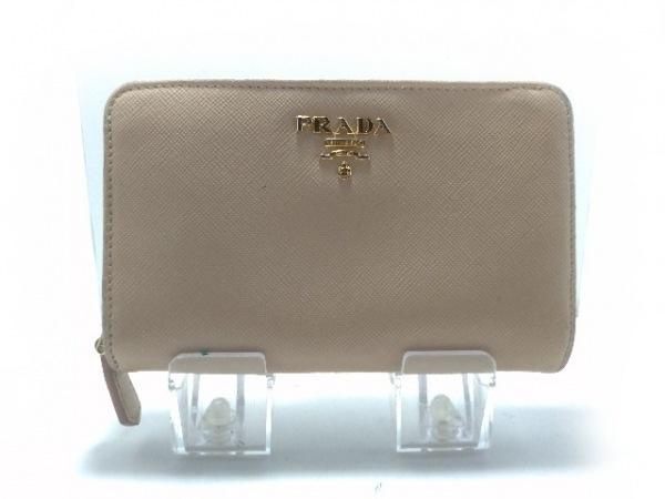 PRADA(プラダ) 2つ折り財布 - ベージュ ラウンドファスナー レザー