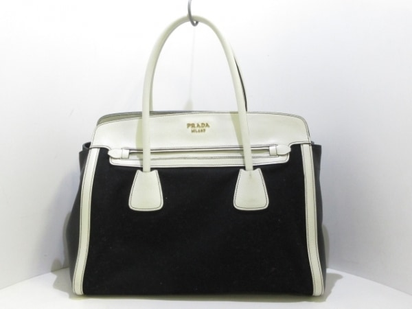 PRADA(プラダ) トートバッグ美品  - 黒×白 革タグ キャンバス×レザー