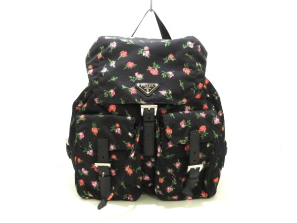 PRADA(プラダ) リュックサック美品  - 1BZ811 黒×ピンク×グリーン 花柄 ナイロン