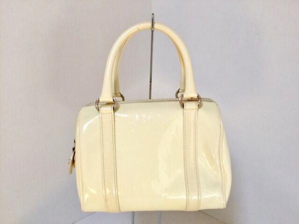 クリスチャンディオール ハンドバッグ美品  ロゴグラム アイボリー 型押し加工