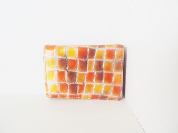 コッコフィオーレ パスケース オレンジ×ダークグリーン×マルチ 型押し加工