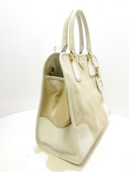 PRADA(プラダ) ハンドバッグ - ベージュ×アイボリー 革タグ キャンバス×レザー