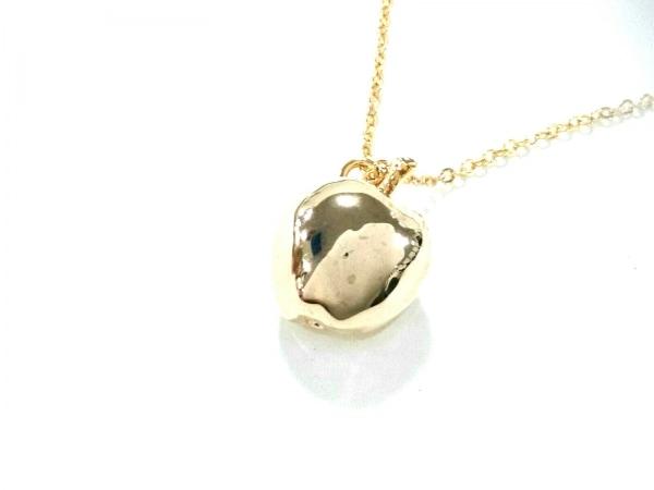 e.m.(イーエム) ネックレス美品  金属素材 ゴールド リンゴ