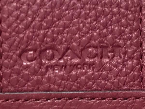 COACH(コーチ) キーケース美品  シグネチャー柄 ボルドー×カーキ 6連フック