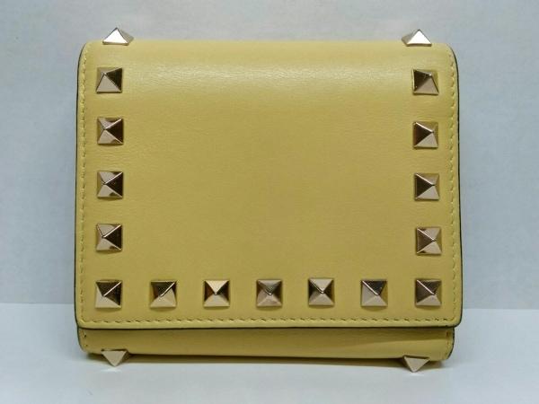 バレンチノガラバーニ 3つ折り財布 イエロー×ゴールド スタッズ レザー×金属素材