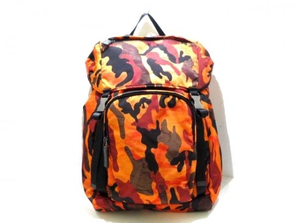 PRADA(プラダ) リュックサック美品  - V135 オレンジ×黒×マルチ 迷彩柄 ナイロン